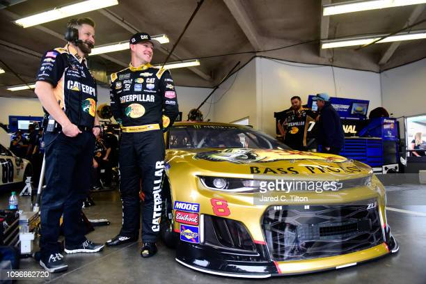 Daniel Hemric driver of the Bass Pro Shops/Caterpillar Chevrolet stands in the garage area during practice for the Monster Energy NASCAR Cup Series...