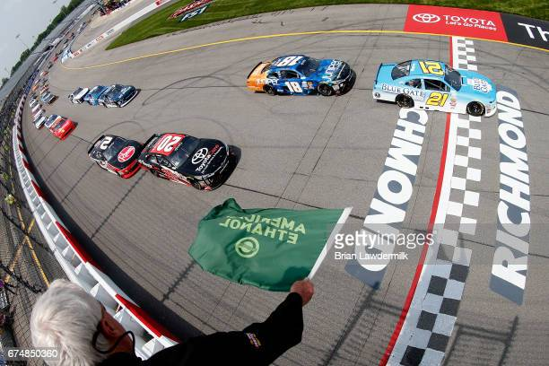 Daniel Hemric driver of the Blue Gate Bank Chevrolet and Kyle Benjamin driver of the ToyotaCare Toyota lead the field to green during the NASCAR...