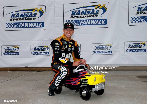 Daniel Hemric driver of the Caterpillar Chevrolet poses with a pole award pedal car after qualifying for the Monster Energy NASCAR Cup Series...