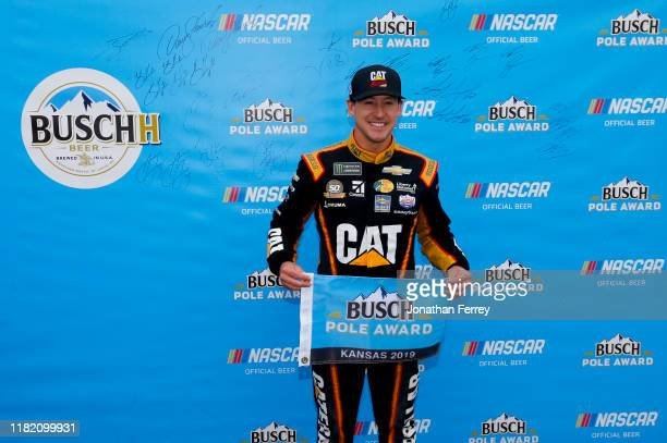 Daniel Hemric driver of the Caterpillar Chevrolet poses with the pole award after qualifying for the Monster Energy NASCAR Cup Series Hollywood...