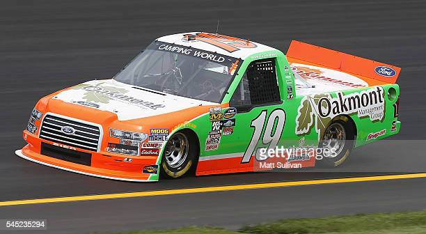 Daniel Hemric driver of the Oakmont Management Group Ford practices for the NASCAR Camping World Truck Series Buckle Up In Your Truck 225 at Kentucky...