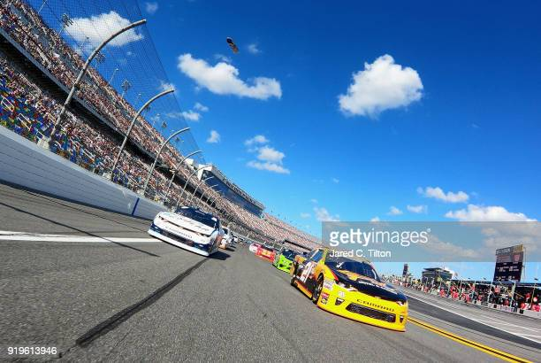 Daniel Hemric driver of the South Point Hotel Casino Chevrolet and Kyle Larson driver of the DC Solar Chevrolet drive on a pace lap during the NASCAR...
