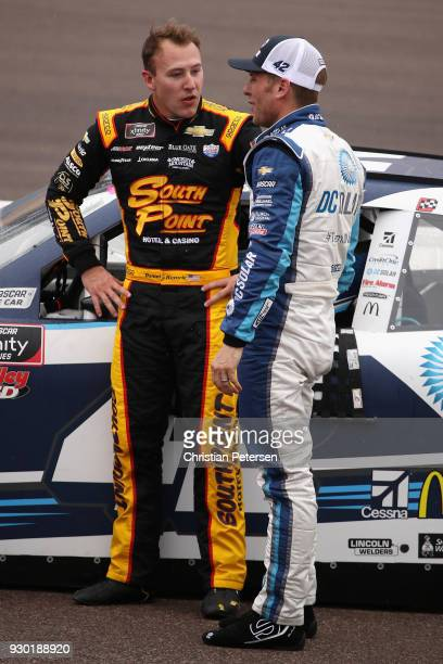 Daniel Hemric driver of the South Point Hotel Casino Chevrolet and Jamie McMurray driver of the DC Solar Chevrolet talk on pit road during ared flag...
