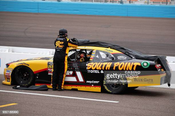 Daniel Hemric driver of the South Point Hotel Casino Chevrolet had his car covered on pit road during a red flag for rain during the NASCAR Xfinity...