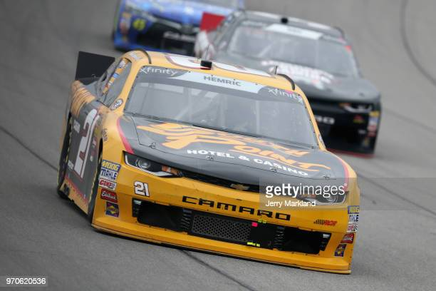 Daniel Hemric driver of the South Point Hotel Casino Chevrolet leads a pack of cars during the NASCAR Xfinity Series LTi Printing 250 at Michigan...