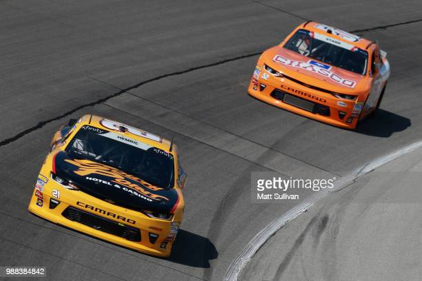Daniel Hemric driver of the South Point Hotel Casino Chevrolet leads David Starr driver of the Chasco/Whataburger Chevrolet during the NASCAR Xfinity...