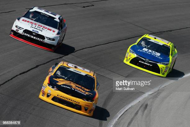 Daniel Hemric driver of the South Point Hotel Casino Chevrolet leads Brandon Jones driver of the Menards/JeldWen Toyota and Paul Menard driver of the...