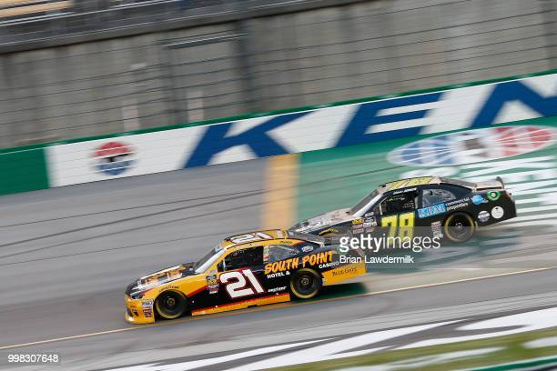 Daniel Hemric driver of the South Point Hotel Casino Chevrolet leads Blake Jones driver of the Tennessee XXX Moonshine Chevrolet during the NASCAR...