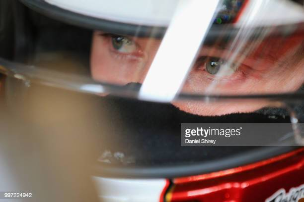 Daniel Hemric driver of the South Point Hotel Casino Chevrolet sits in his car during practice for the NASCAR Xfinity Series Alsco 300 at Kentucky...