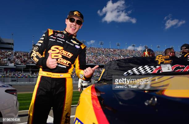 Daniel Hemric driver of the South Point Hotel Casino Chevrolet stands on the grid prior to the NASCAR Xfinity Series PowerShares QQQ 300 at Daytona...