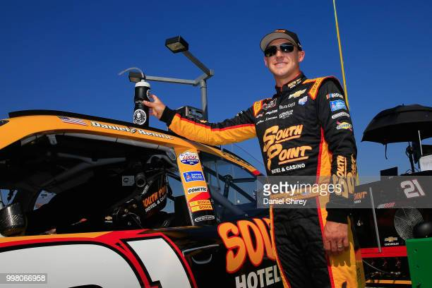 Daniel Hemric driver of the South Point Hotel Casino Chevrolet stands on the grid during qualifying for the NASCAR Xfinity Series Alsco 300 at...