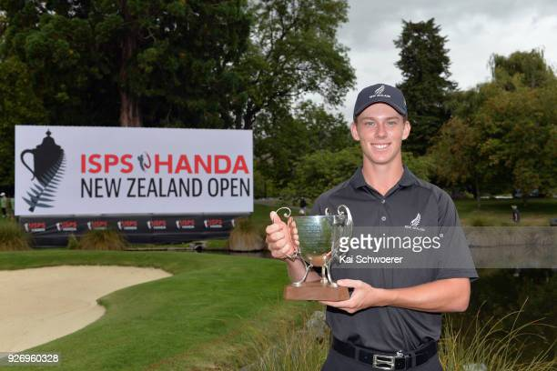 Daniel Hillier of New Zealand poses with the Bledisloe Cup during day four of the ISPS Handa New Zealand Golf Open at Millbrook Golf Resort on March...