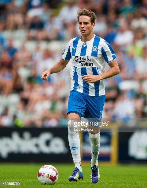 Daniel Hoegh of OB Odense controls the ball during the Danish Superliga match between OB Odense and Hobro IK at TREFOR Park on July 20 2014 in Odense...