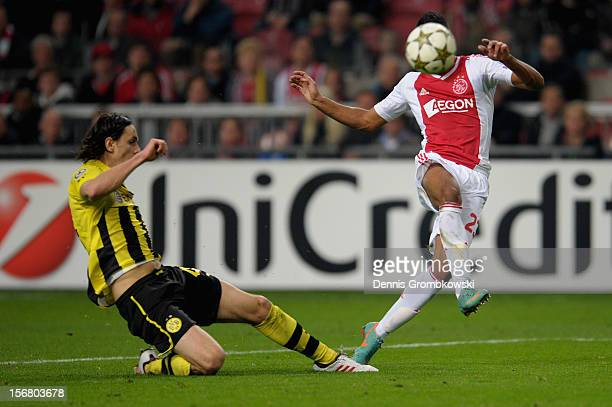 Daniel Hoesen of Amsterdam scores his team's first goal under the pressure of Neven Subotic of Dortmund during the UEFA Champions League Group D...