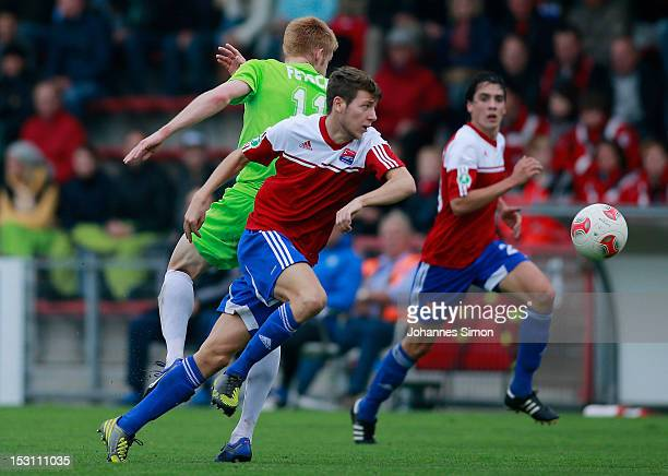 Daniel Hofstetter and Markus Schwabl of Unterhaching battles for the ball with Mathias Fetsch of Offenbach during the Third League match between...