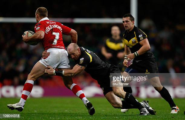 Daniel Holdsworth of Salford is tackled by Gareth Thomas of Crusaders during the Engage Super League Match between Crusaders RL and Salford City Reds...