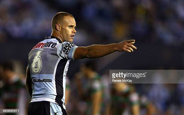 Daniel Holdworth of the Sharks directs play during the round 11 NRL match between the Cronulla-Sutherland Sharks and the South Sydney Rabbitohs at...