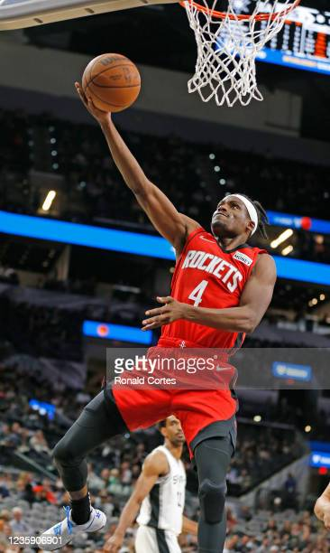 Daniel House Jr. #4 of the Houston Rockets drives for two against the San Antonio Spurs in a pre-season game at AT&T Center on October 2, 2021 in San...