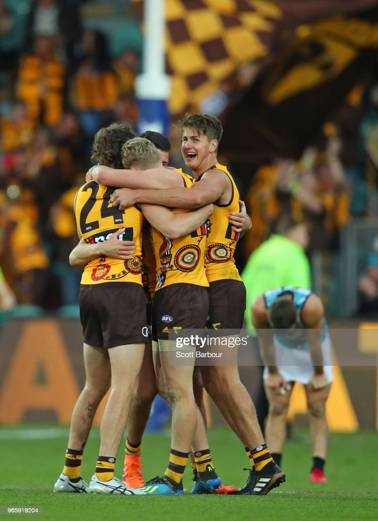 Daniel Howe of the Hawks and Ben Stratton of the Hawks celebrate at the final siren during the round 11 AFL match between the Hawthorn Hawks and the Port Adelaide Power at University of Tasmania Stadium on June 2, 2018 in Launceston, Australia.