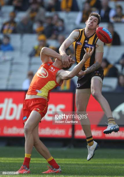 Daniel Howe of the Hawks and Tom Lynch of the Suns compete for the ball during the round 12 AFL match between the Hawthorn Hawks and the Gold Coast...