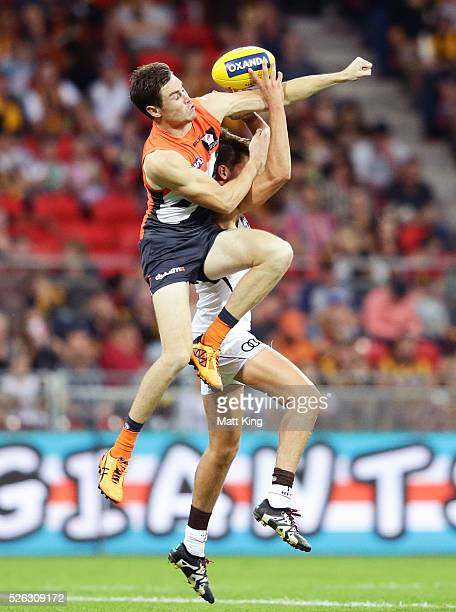 Daniel Howe of the Hawks is challenged by Jeremy Cameron of the Giants during the round six AFL match between the Greater Western Sydney Giants and...
