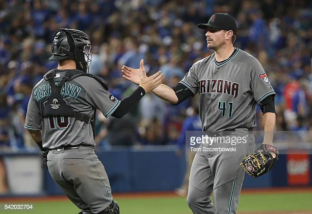 Daniel Hudson of the Arizona Diamondbacks celebrates a victory with Chris Herrmann against the Toronto Blue Jays on June 21 2016 at Rogers Centre in...