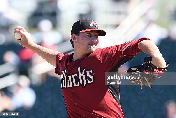 Daniel Hudson of the Arizona Diamondbacks delivers a pitch against the Cleveland Indians on March 13 2015 in Goodyear Arizona
