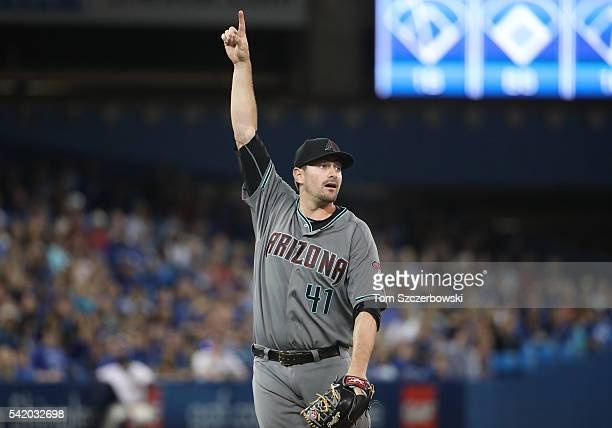 Daniel Hudson of the Arizona Diamondbacks points to an infield pop up that was caught for the first out of the ninth inning during MLBgame action...