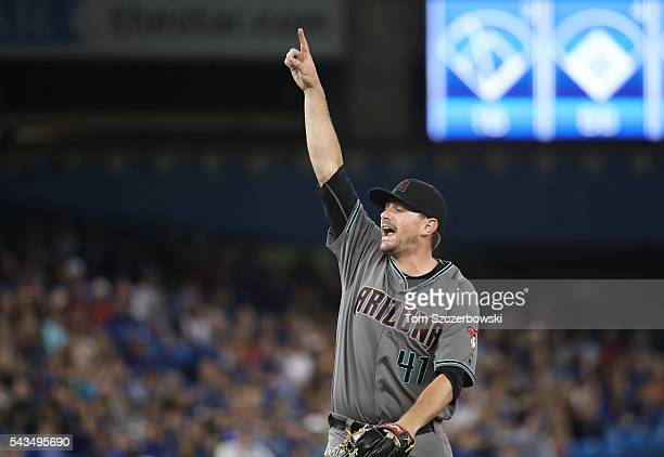 Daniel Hudson of the Arizona Diamondbacks points to an infield pop up that would be caught for the first out of the ninth inning during MLB game...
