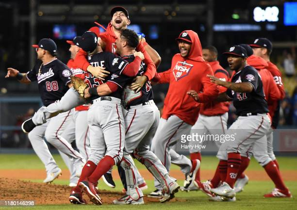 Daniel Hudson Sean Doolittle and catcher Yan Gomes of the Washington Nationals celebrate the final out of the tenth inning as the Nationals defeated...