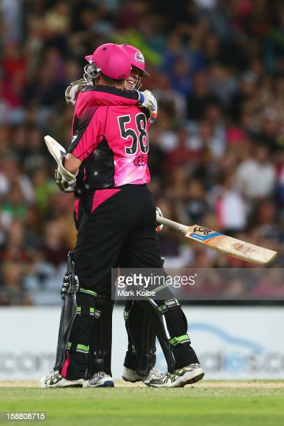Daniel Hughes and Brett Lee of the Sixers celebrate victory during the Big Bash League match between Sydney Thunder and the Sydney Sixers at ANZ...