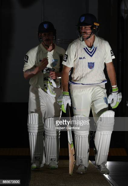 Daniel Hughes and Nic Maddinson of NSW walk out to bat during day three of the Sheffield Shield match between New South Wales and Tasmania at...