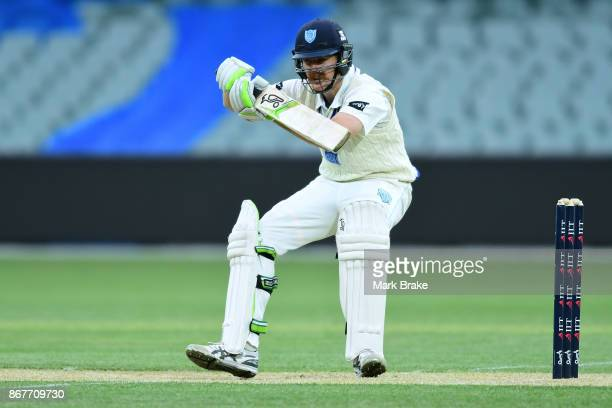 Daniel Hughes of New South Wales avoids a Joe Mennie of South Australia bouncer during day three of the Sheffield Shield match between South...