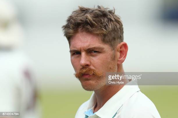 Daniel Hughes of New South Wales looks on during day three of the Sheffield Shield match between Queensland and New South Wales at Allan Border Field...