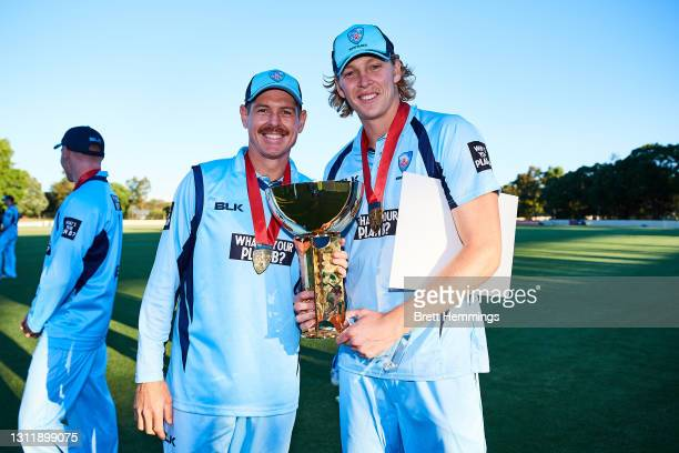 Daniel Hughes of NSW and Jack Edwards of NSW pose for a photo with the trophy during the 2021 Marsh One Day Cup Final match between New South Wales...