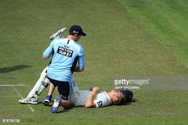 Daniel Hughes of NSW receives attention for an injury during day two of the Sheffield Shield match between New South Wales and Victoria at North...