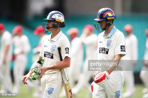 Daniel Hughes of the Blues and Kurtis Patterson of the Blues walk from the field with a newly designed helmets during day one of the Sheffield Shield...