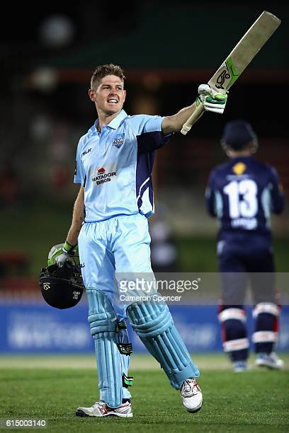 Daniel Hughes of the Blues celebrates scoring a century during the Matador BBQs One Day Cup match between New South Wales and Victoria at North...