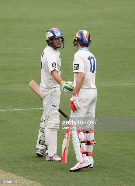 Daniel Hughes of the Blues shakes hands with Kurtis Patterson of the Blues after scoring a half century during day one of the Sheffield Shield match...