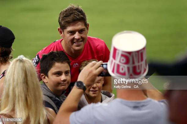 Daniel Hughes of the Sixers greets fans after the Sixers victory during the Big Bash League match between the Sydney Sixers and the Adelaide Strikers...