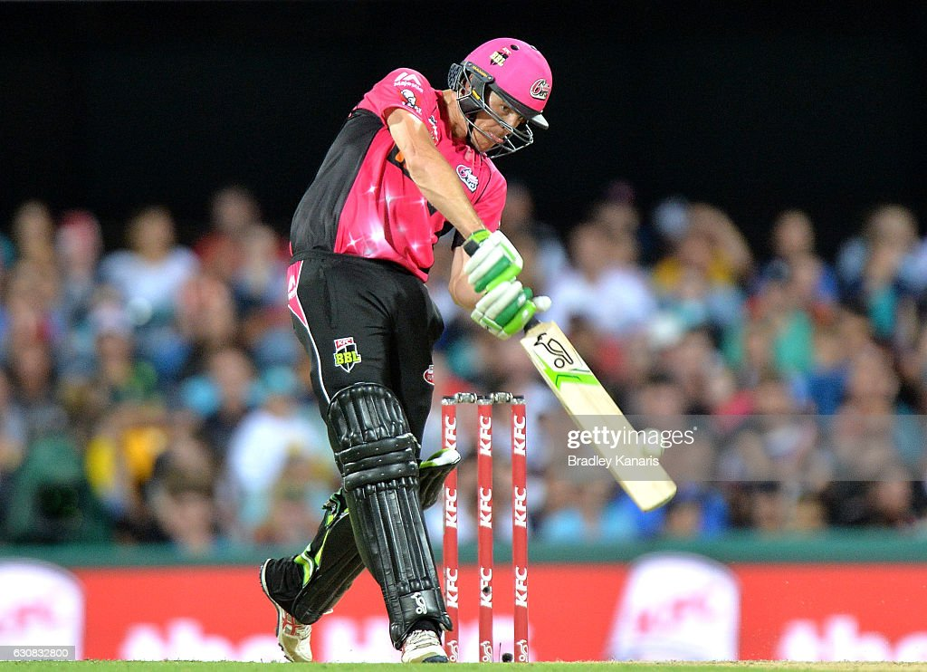 Daniel Hughes of the Sixers hits the ball over the boundary for a six during the Big Bash League match between the Brisbane Heat and Sydney Sixers at The Gabba on January 3, 2017 in Brisbane, Australia.