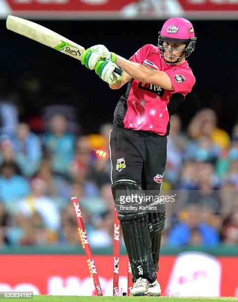 Daniel Hughes of the Sixers is bowled off the bowling of Ben Cutting of the Heat during the Big Bash League match between the Brisbane Heat and...