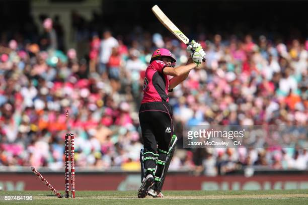 Daniel Hughes of the Sixers is dismissed by Jhye Richardson of the Scorchers during the Big Bash League match between the Sydney Sixers and the Perth...