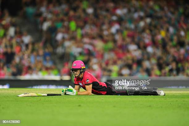 Daniel Hughes of the Sixers lays on the ground after diving into his crease during the Big Bash League match between the Sydney Sixers and the Sydney...
