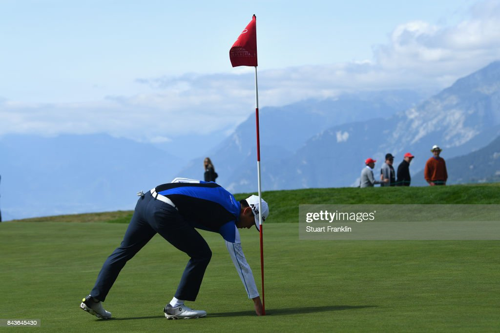 Daniel Im of The United States collects his ball after a hole-in-one on the 8th during day one of the 2017 Omega European Masters at Crans-sur-Sierre Golf Club on September 7, 2017 in Crans-Montana, Switzerland.