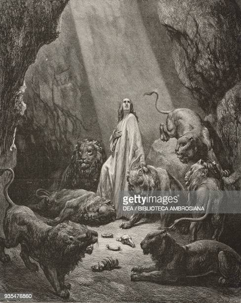 Daniel is thrown into the den of lions engraving by Gustave Dore from The Holy Scriptures containing the Old and New Testaments Translated from The...