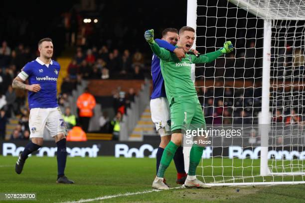 Daniel Ivarsen of Oldham Athletic celebrates with team mates after saving a penalty shot from Aleksandar Mitrovic of Fulham during the FA Cup Third...