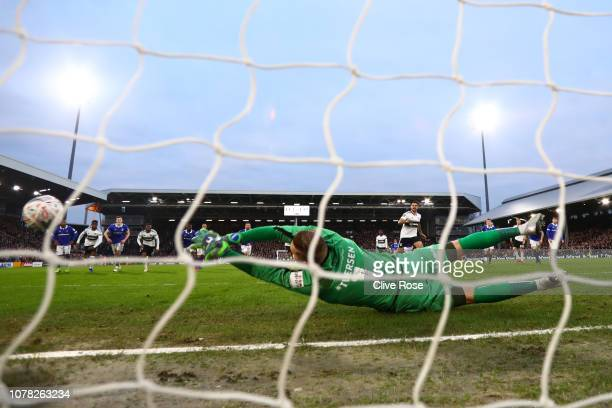 Daniel Ivarsen of Oldham Athletic saves a penalty shot from Aleksandar Mitrovic of Fulham during the FA Cup Third Round match between Fulham and...