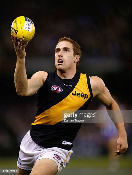Daniel Jackson of the Tigers gathers the ball during the round 15 AFL match between the North Melbourne Kangaroos and the Richmond Tigers at Etihad...