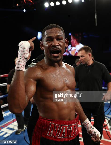Daniel Jacobs celebrates after winning a split decision against Sergiy Derevyanchenko after their IBF middleweight title fight at Madison Square...